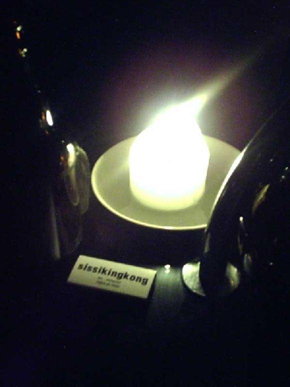 Kerze mit eKamina-Logo